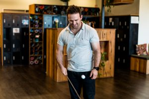 Physiotherapist Ben juggling a golf ball in our beautiful practice foyer